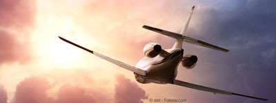 Private Jet PLane in the sky at sunset